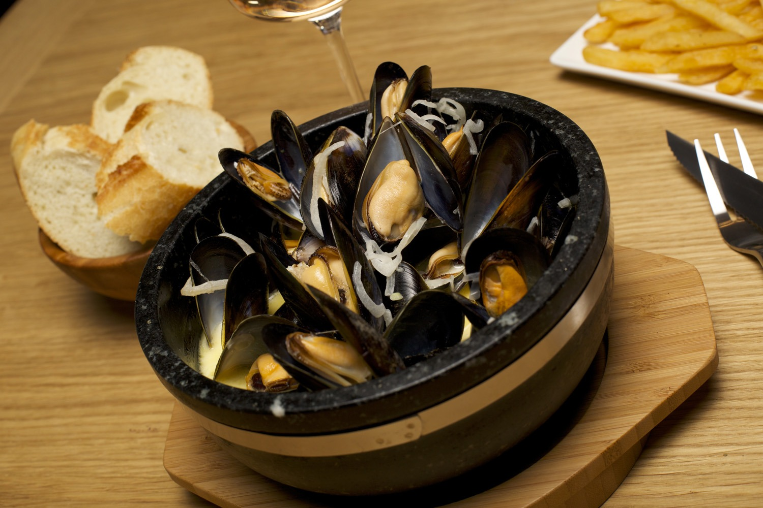 Moules Marinieres served in The SteakStones Sizzling Bowl