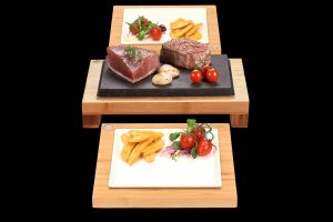 The Raised Steak Sharer & Server SetsFillet Steak, Scallops and Tuna Sizzling on Steak on the Stones Lava Stone Cooking Products. The best Hot Rocks cooking products guaranteed. Bamboo and ceramic serving sets offer the more versatility than Black Rock Grill products..